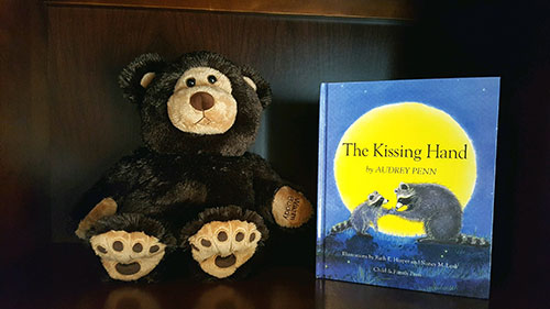 A Warm Buddy and a book comforting anxious children