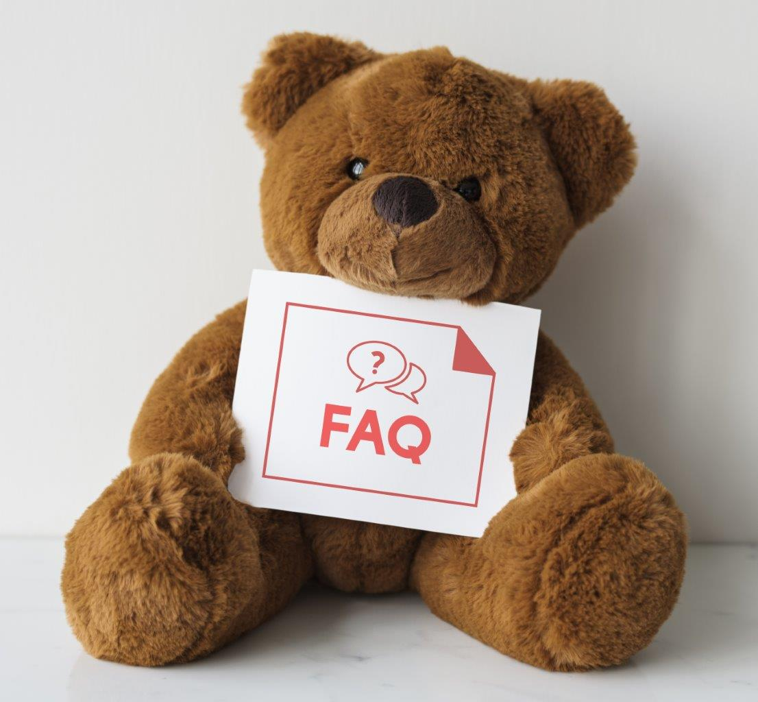 Teddy Bear Holding FAQ sign for Comforting Anxious Children