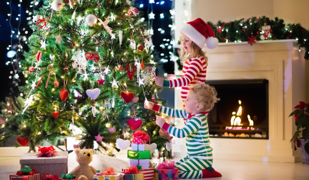 children by Christmas tree